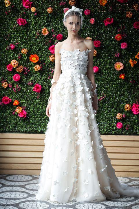 e4809e4b793 Bridal Fashion Week Wedding Dresses. Getty Images. Lela Rose. Larger flower  appliqué ...