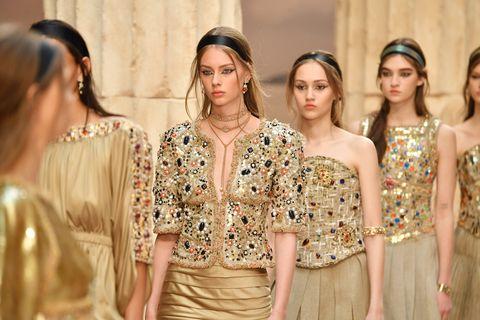 Fashion, Fashion model, Clothing, Haute couture, Dress, Yellow, Fashion show, Shoulder, Event, Fashion design,