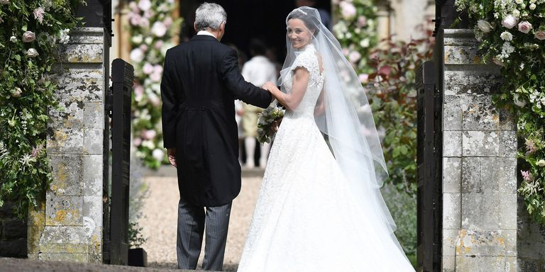 Pippa middleton looks stunning in wedding dress as she for Giles deacon wedding dresses