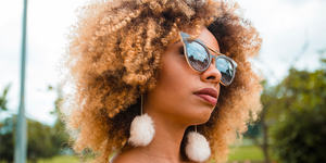 How To Style Curly Hair When It's Hot