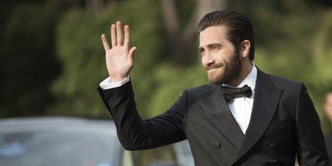 Suit, Formal wear, Tuxedo, Gesture, Finger, White-collar worker, Hand, Businessperson, Thumb, Blazer,