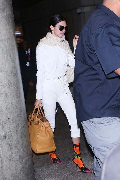 Kendall Jenner wears Balenciaga floral boots in airport