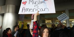 Protestors Rally Against Muslim Immigration Ban At Miami Airport | ELLE UK