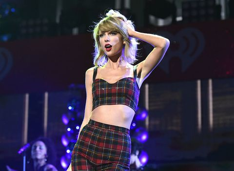 Taylor Swift performs onstage during iHeartRadio Jingle Ball in New York City | ELLE UK