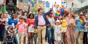 Prime Minister Justin Trudeau waves to the crowd as he, his wife Sophie Gregoire Trudeau and their children Xavier and Ella-Grace march in the Pride Parade in Toronto | ELLE UK