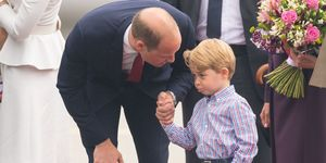 The Duke of Cambridge at Warsaw's Chopin Airport with Prince George at the start of their five-day tour of Poland and Germany