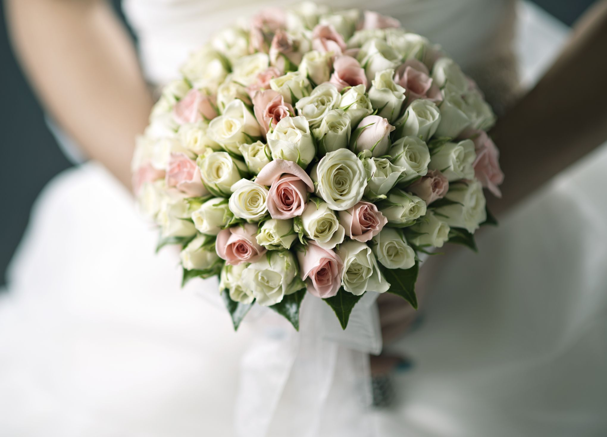This brides diamond encrusted bouquet is the floral arrangement of this brides diamond encrusted bouquet is the floral arrangement of wedding dreams izmirmasajfo