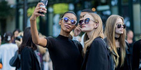 Models taking selfie   ELLE UK