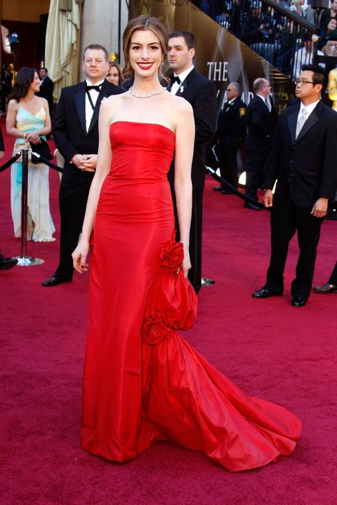 Gown, Red carpet, Dress, Carpet, Clothing, Formal wear, Flooring, Red, Premiere, Fashion model,