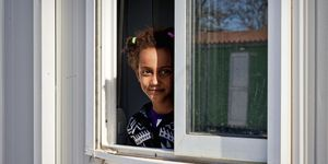 A Somali refugee girl guest of the Temporary accommodation centre for immigrants in Eleonas of Athens, 11 Febraury 2016 | ELLE UK