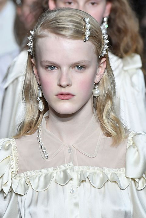 """<p>And like the previous slide but more extra, this look takes a three-prong approach to defining and bringing light to&nbsp;the face: one pearl barrette at the arch, and two more at the ends of the brows. Add blush, and <a href=""""http://www.marieclaire.com/beauty/news/a13883/skin-perfecting-techniques-art-history/"""" target=""""_blank"""" data-tracking-id=""""recirc-text-link"""">you're a lit-from-within Renaissance figure</a>.&nbsp;</p>"""