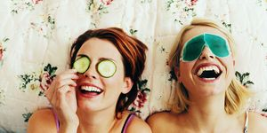 Two Female Teenagers Lying in Bed Wearing Eye Masks | ELLE UK