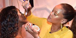 Rihanna applying make-up Fenty Beauty product