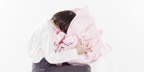 White, Pink, Head, Nose, Arm, Outerwear, Textile, Neck, Sitting, Sleep,