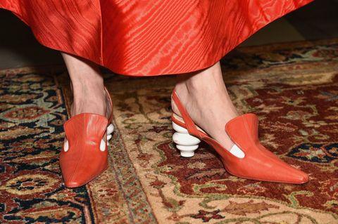 Red, Footwear, Leg, Human leg, Orange, Shoe, High heels, Ankle, Close-up, Joint,