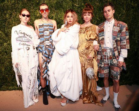 People, Fashion, Eyewear, Dress, Fashion design, Event, Fun, Sunglasses, Family, Costume,