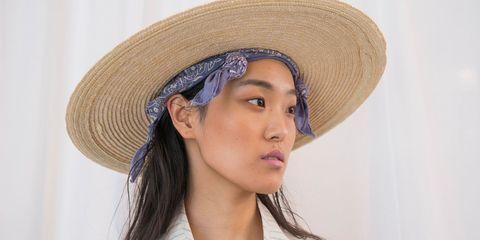 Lip, Hat, Skin, Chin, Jaw, Headgear, Fashion accessory, Organ, Costume accessory, Eyelash,