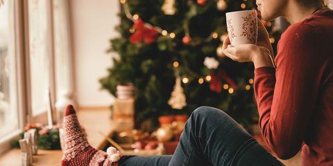 Christmas, Christmas stocking, Tree, Christmas eve, Arm, Christmas tree, Christmas decoration, Sitting, Hand, Photography,