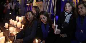 Lebanese activists take part in a candle vigil to raise awareness over violence against women, outside Beirut's National Museum on December 23, 2017. Dozens of people demonstrated in Beirut and lit candles to mourn the lives of four women, including a British citizen, who were all killed in Lebanon in various incidents in just one week | ELLE UK