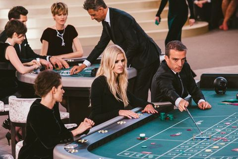Arm, Indoor games and sports, Recreation, Leisure, Room, Games, Poker table, Gambling, Casino, Baize,