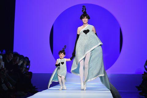 Head, Fashion, Costume design, Performance, Stage, Fashion show, Violet, Public event, Fashion model, Haute couture,