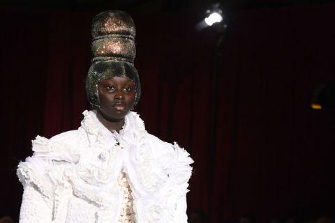 Headgear, Tradition, Performance art, Costume design, Headpiece, Drama, Fashion design, Acting, Fashion model, Spectacle,