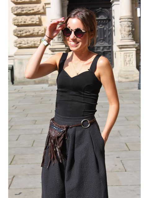 Clothing, Eyewear, Arm, Glasses, Vision care, Brown, Sunglasses, Sleeve, Shoulder, Joint,