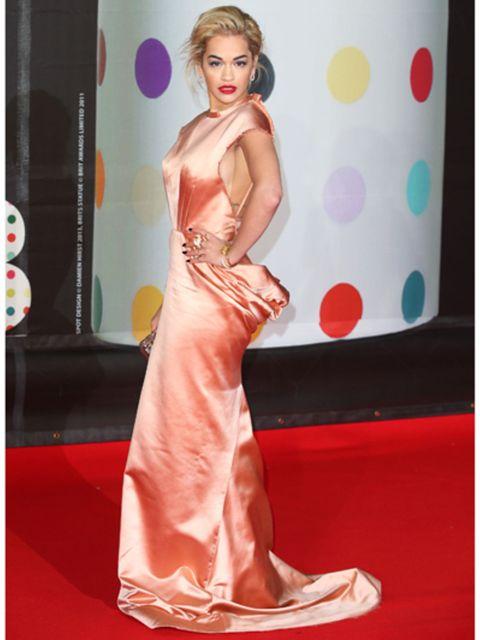 Human, Shoulder, Dress, Flooring, Red, Pink, Style, Carpet, One-piece garment, Fashion,