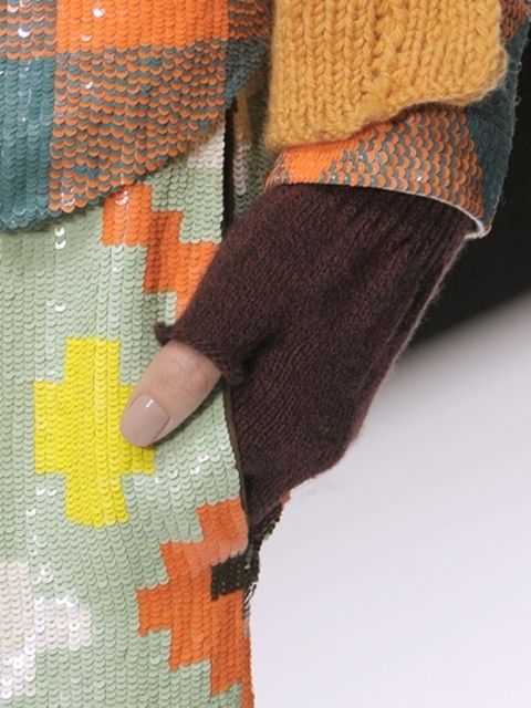 Pattern, Textile, Human leg, Orange, Woolen, Wool, Knitting, Creative arts, Craft, Thread,