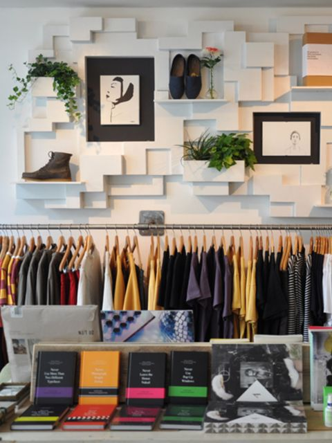 Room, Textile, Clothes hanger, Shelving, Collection, Shelf, Retail, Home accessories, Closet, Picture frame,