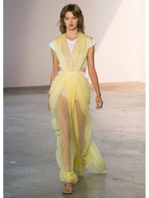 Yellow, Shoulder, Textile, Fashion show, Style, Fashion model, Formal wear, Runway, Waist, Fashion,