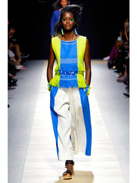 Yellow, Shoulder, Fashion show, Runway, Style, Waist, Jewellery, Fashion model, Fashion, Street fashion,