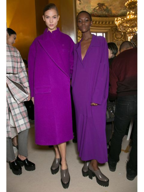 Footwear, Standing, Purple, Magenta, Plaid, One-piece garment, Fashion design, Tradition, Tartan, Silk,