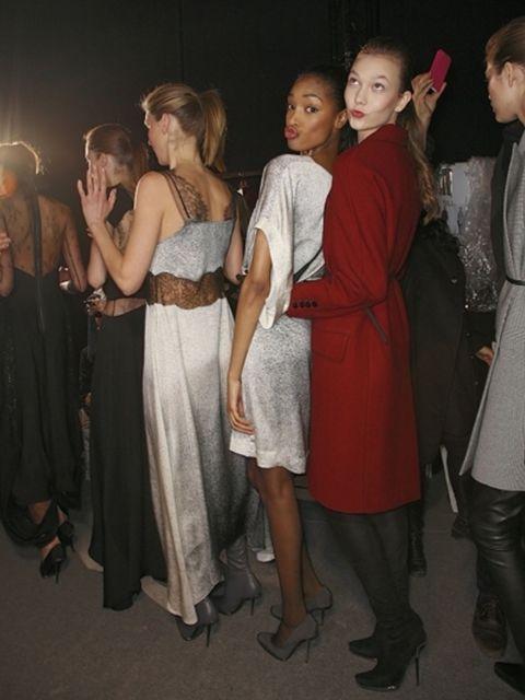 Hair, Face, Leg, Fashion, Dress, One-piece garment, Leather, Day dress, Tights, Fashion design,