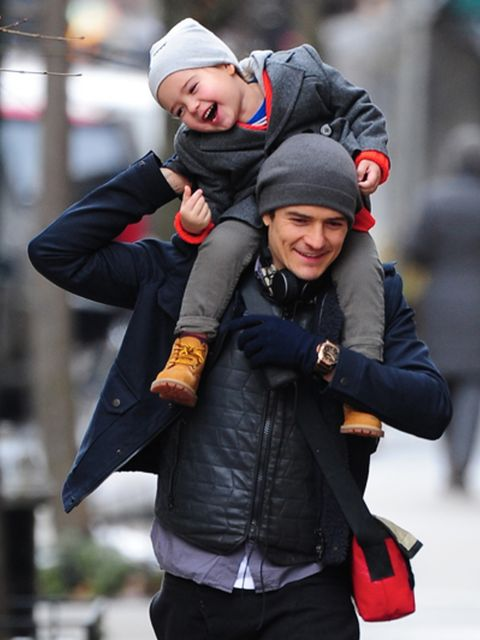 Winter, Smile, Jacket, Sleeve, Cap, Outerwear, Happy, Facial expression, Street fashion, Glove,