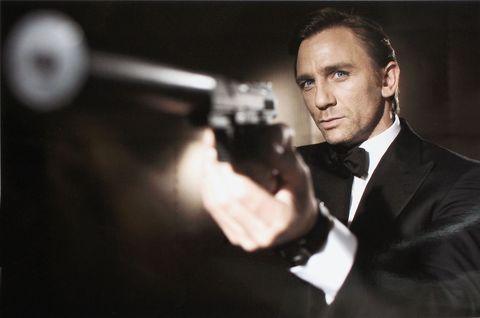 Shooting, Gun, Firearm, Coat, Suit, Formal wear, Collar, Dress shirt, Shotgun, Blazer,