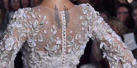 Clothing, Dress, Shoulder, Gown, Style, Headgear, Bridal clothing, Headpiece, Fashion model, Embellishment,