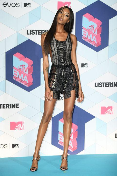Human, Leg, Human body, Shoulder, Human leg, Style, Fashion model, Dress, Flooring, Thigh,