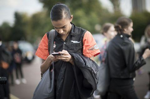 Street fashion, Mobile phone, Bag, Luggage and bags, Camera, Portable communications device, Handbag, Gadget, Telephony, Communication Device,