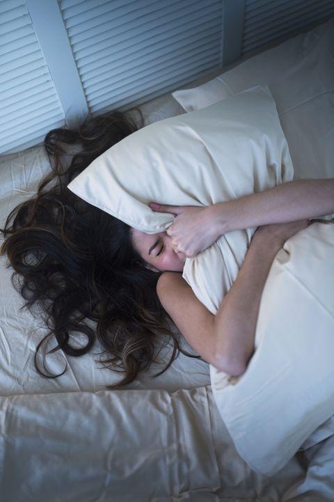 Hair, Leg, Long hair, Arm, Hand, Sleep, Room, Textile, Linens, Bed sheet,