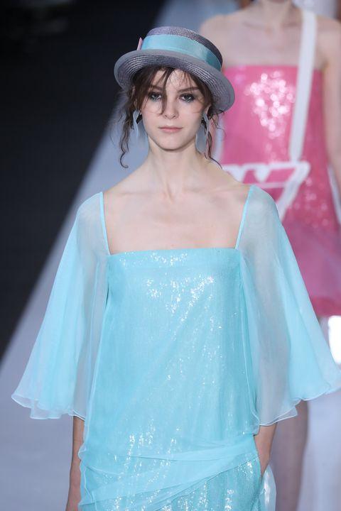 Clothing, Shoulder, Fashion, Blue, Fashion model, Fashion show, Beauty, Turquoise, Skin, Haute couture,