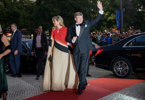 Red carpet, Carpet, Event, Luxury vehicle, Ceremony, Dress, Fashion, Wedding, Car, Flooring,