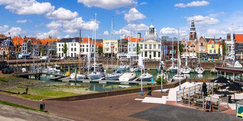 Marina, Harbor, Town, Sky, Dock, Waterway, Urban area, Human settlement, Daytime, Port,