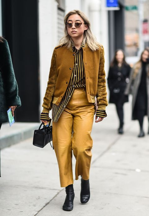 Fashion, Street fashion, Fashion model, Clothing, Fashion show, Snapshot, Yellow, Human, Outerwear, Footwear,