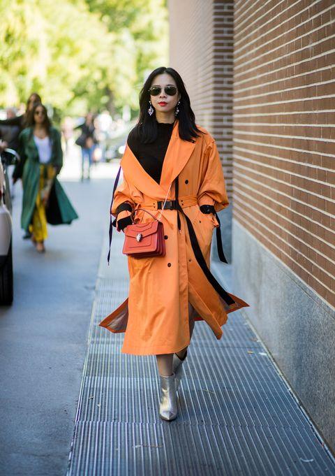Clothing, Fashion, Orange, Street fashion, Fashion model, Yellow, Outerwear, Fashion show, Coat, Kimono,