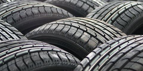 Tire, Automotive tire, Automotive wheel system, Automotive exterior, Rim, Synthetic rubber, Tread, Auto part, Carbon, Black,