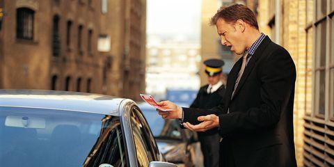 Suit, Formal wear, Coat, Blazer, Vehicle door, Street fashion, White-collar worker, Windshield, Automotive window part, Automotive mirror,