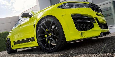 Tire, Wheel, Motor vehicle, Automotive design, Vehicle, Yellow, Land vehicle, Automotive wheel system, Rim, Car,