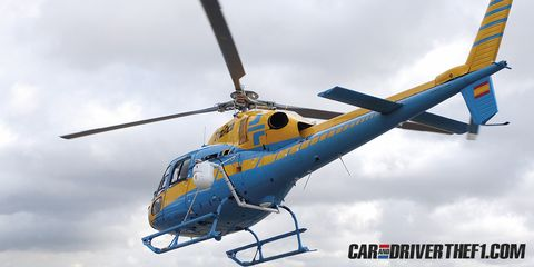 Helicopter, Rotorcraft, Mode of transport, Aircraft, Blue, Daytime, Sky, Natural environment, Air travel, Transport,