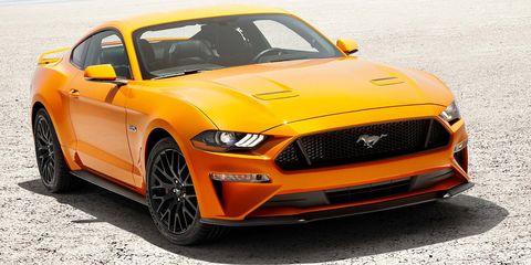 Tire, Motor vehicle, Wheel, Automotive design, Yellow, Vehicle, Hood, Headlamp, Automotive tire, Grille,